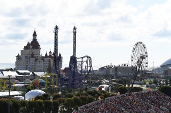 The funfair behind a packed grandstand