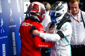 Charles Leclerc, Ferrari, celebrates in victory in parc ferme with Valtteri Bottas, Mercedes AMG F1