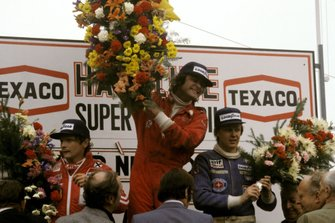 Podium: Second place Niki Lauda, Ferrari, Race winner Gunnar Nillson, Lotus, third place Ronnie Peterson, Tyrrell