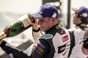 Simon Evans, Team Asia New Zealand, 3rd position, sprays champagne on the podium