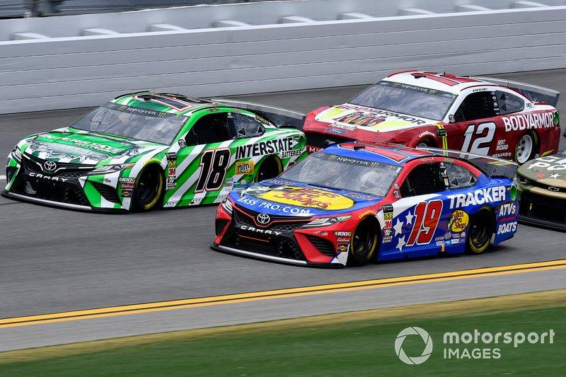 Kyle Busch, Joe Gibbs Racing, Toyota Camry Interstate Batteries, and Martin Truex Jr., Joe Gibbs Racing, Toyota Camry Bass Pro Shops / TRACKER ATVs & Boats / USO