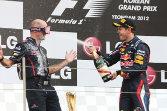 Podium: race winner Sebastian Vettel, Red Bull Racing sprays Adrian Newey, Red Bull Racing Chief Technical Officer on the podium