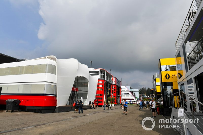 A scenic view of the paddock, including Renault and Ferrari transporters and hospitality units