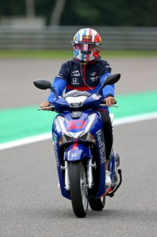 Pierre Gasly, Toro Rosso STR14, rides a scooter