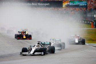 Lewis Hamilton, Mercedes AMG F1 W10, leads Valtteri Bottas, Mercedes AMG W10, Kimi Raikkonen, Alfa Romeo Racing C38, Max Verstappen, Red Bull Racing RB15, and the rest of the field