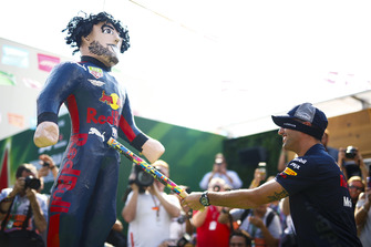 Daniel Ricciardo, Red Bull Racing, hits an impersonator with stick