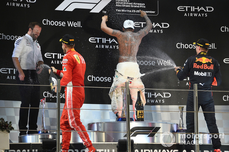 (L to R): Bradley Lord, Head of Mercedes-Benz Motorsport Communications, Sebastian Vettel, Ferrari, Lewis Hamilton, Mercedes AMG F1 and Max Verstappen, Red Bull Racing celebrate by spraying Rose Water on the podium