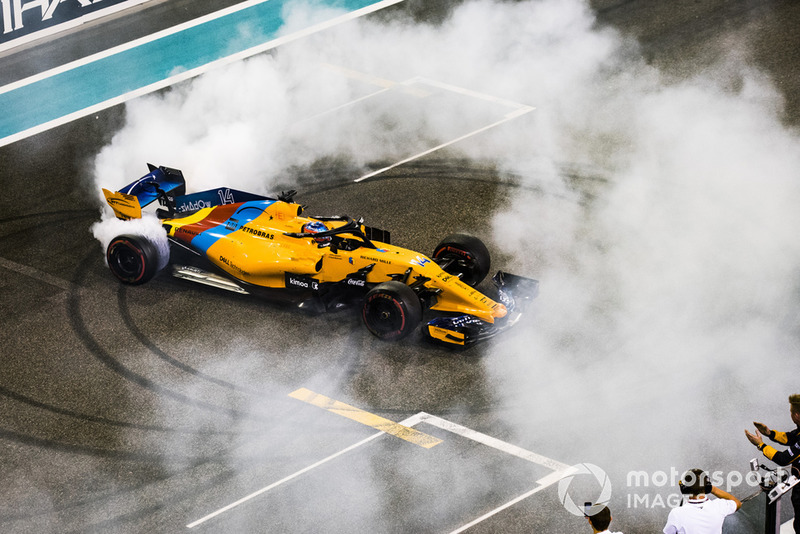 Fernando Alonso, McLaren MCL33, performs donuts on the grid at the end of the race