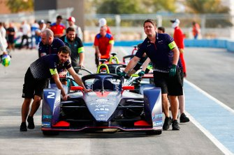 Mechanics push Sam Bird car, Envision Virgin Racing, Audi e-tron FE05 down the pit lane