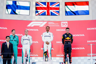 Second place Valtteri Bottas, Mercedes AMG F1, Race winner Lewis Hamilton, Mercedes AMG F1, and third place Max Verstappen, Red Bull Racing, on the podium