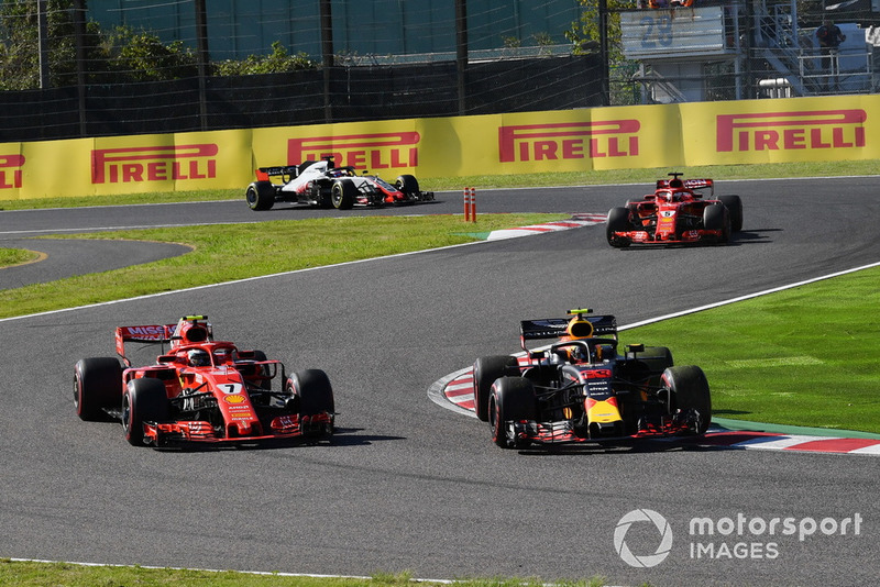 Kimi Raikkonen, Ferrari SF71H and Max Verstappen, Red Bull Racing RB14