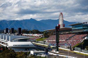 Pierre Gasly, Scuderia Toro Rosso STR13, leads Sergio Perez, Racing Point Force India VJM11, and Kimi Raikkonen, Ferrari SF71H