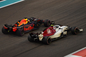Charles Leclerc, Sauber C37 and Max Verstappen, Red Bull Racing RB14 battle