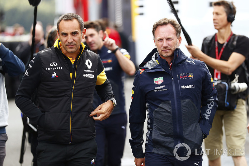 Cyril Abiteboul, Managing Director, Renault Sport F1 Team and Christian Horner, Team Principal, Red Bull Racing, in the paddock