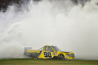Grant Enfinger, ThorSport Racing, Ford F-150 celebrates with a burnout after winning