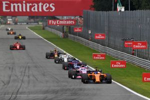 Fernando Alonso, McLaren MCL33 leads Sergio Perez, Racing Point Force India VJM11