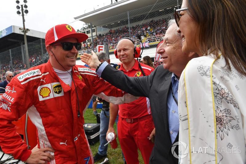 Kimi Raikkonen, Ferrari con Jean Todt, presidente de la FIA, y la mujer de Todt, Michelle Yeoh