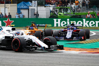 Sergey Sirotkin, Williams FW41, leads as Pierre Gasly, Toro Rosso STR13, goes leaves the track whilst fighting with Fernando Alonso, McLaren MCL33