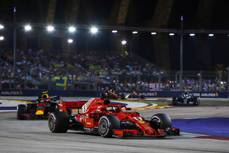 Sebastian Vettel, Ferrari SF71H, leads Max Verstappen, Red Bull Racing RB14, and Valtteri Bottas, Mercedes AMG F1 W09 EQ Power+