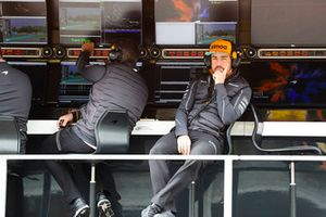 Fernando Alonso, McLaren, on the pit wall