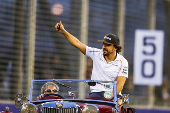 Fernando Alonso, McLaren, waves on the drivers' parade