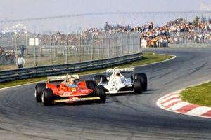 Жиль Вильнёв, Ferrari 312T4, и Алан Джонс, Williams FW07 Ford