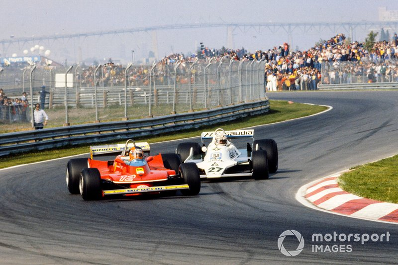 Gilles Villeneuve, Ferrari 312T4 leads Alan Jones, Williams FW07 Ford