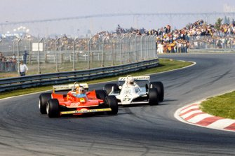 Gilles Villeneuve, Ferrari 312T4 y Alan Jones, Williams FW07 Ford