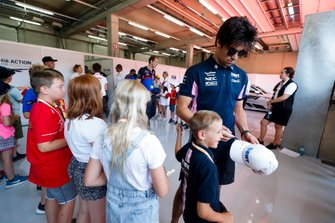 Lance Stroll, Racing Point, signs some autographs for children