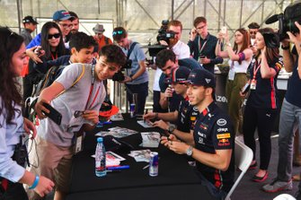 Pierre Gasly, Red Bull Racing takes a selfie with a fan and Max Verstappen, Red Bull Racing