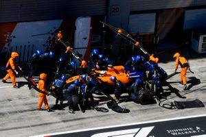Lando Norris, McLaren MCL34 pit atop