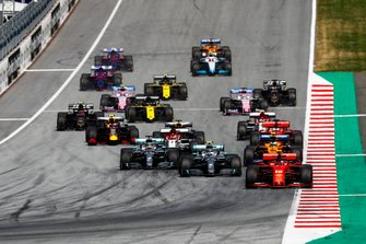 Charles Leclerc, Ferrari SF90 leads Valtteri Bottas, Mercedes AMG W10, Lewis Hamilton, Mercedes AMG F1 W10 and Lando Norris, McLaren MCL34 at the start of the race