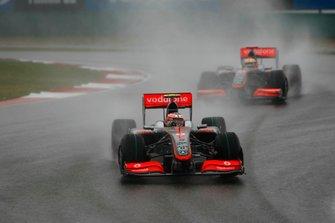 Heikki Kovalainen, McLaren MP4-24, leads Lewis Hamilton, McLaren MP4-24