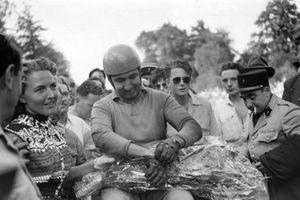 Alberto Ascari celebrates victory
