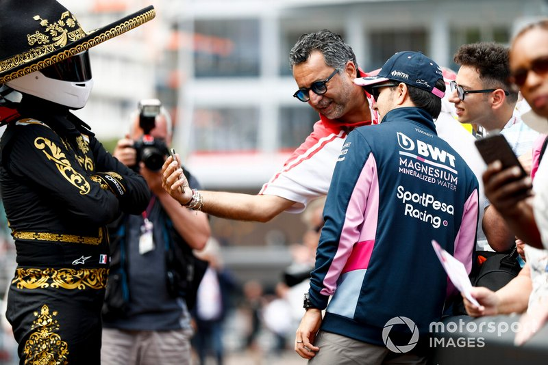 Sergio Perez, Racing Point poses for a selfie with a fan whilst Mario Achi, Mexican GP Promoter watches