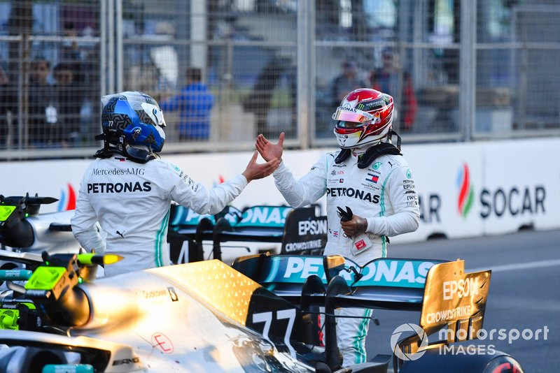 Pole man Valtteri Bottas, Mercedes AMG F1, and Lewis Hamilton, Mercedes AMG F1, congratulate each other after Qualifying