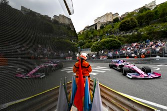 A marshal keeps an eye on the circuit as Sergio Perez, Racing Point RP19, passes