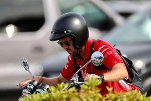Sebastian Vettel, Ferrari, on a motorbike