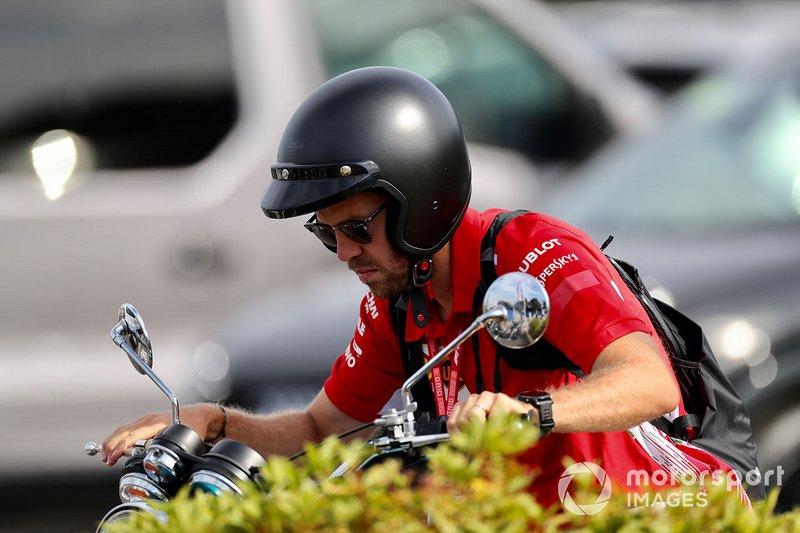 Sebastian Vettel, Ferrari, su una moto