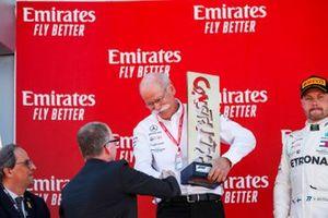 Dr Dieter Zetsche, CEO, Mercedes Benz receives the Winning Constructors trophy on the podium
