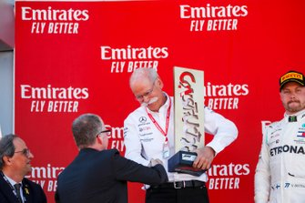 Dr Dieter Zetsche, CEO, Mercedes Benz receives the Winning Constructors trophy on the podium
