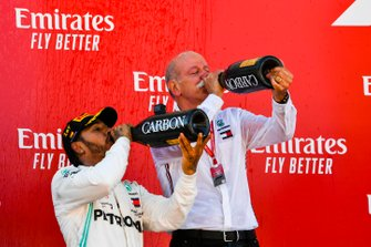 Lewis Hamilton, Mercedes AMG F1, 1st position, and Dr Dieter Zetsche, CEO, Mercedes Benz drink Champagne on the podium