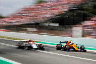 Lando Norris, McLaren MCL34, battles with Antonio Giovinazzi, Alfa Romeo Racing C38