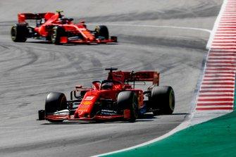 Sebastian Vettel, Ferrari SF90, leads Charles Leclerc, Ferrari SF90