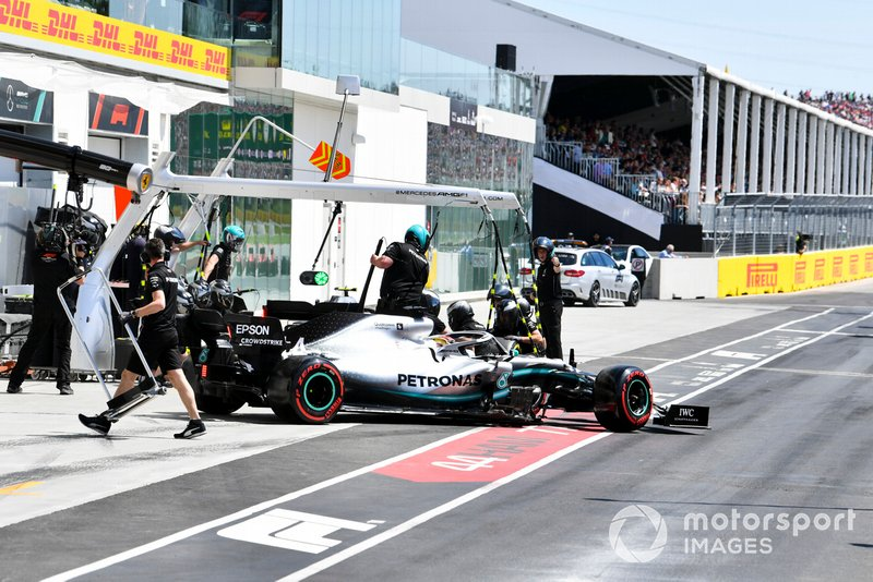 Lewis Hamilton, Mercedes AMG F1 W10, leaves the garage as Valtteri Bottas, Mercedes AMG W10, makes a stop during Qualifying