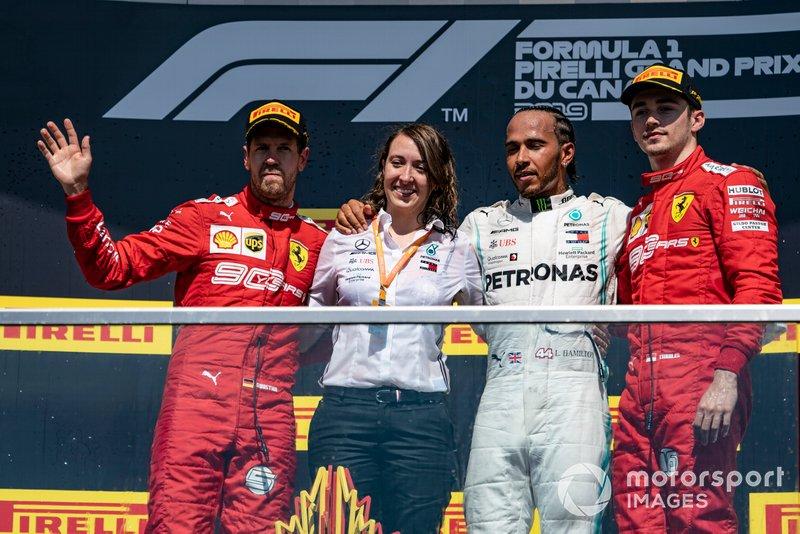 Sebastian Vettel, Ferrari, 2nd position, the Mercedes Constructors trophy delegate, Lewis Hamilton, Mercedes AMG F1, 1st position, and Charles Leclerc, Ferrari, 3rd position, on the podium