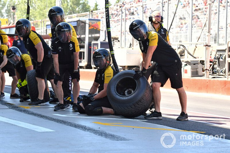 The Renault pit crew get ready for a stop during practice