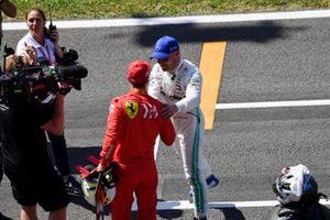 Sebastian Vettel, Ferrari, congratulates Valtteri Bottas, Mercedes AMG F1, on pole position