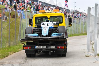 The car of George Russell, Williams Racing FW42, is returned to the pits on a truck