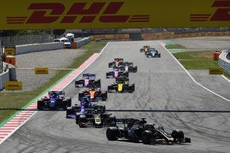 Romain Grosjean, Haas F1 Team VF-19, leads Kevin Magnussen, Haas F1 Team VF-19, Daniil Kvyat, Toro Rosso STR14, Alexander Albon, Toro Rosso STR14, and Carlos Sainz Jr., McLaren MCL34
